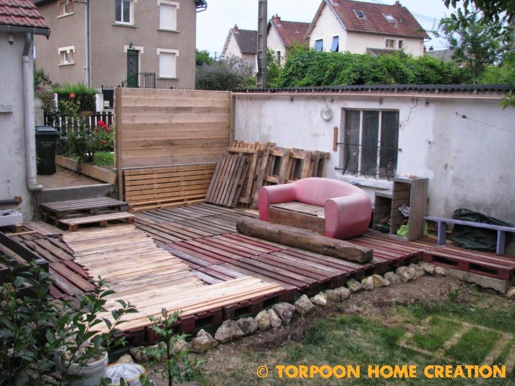 Terrasse en planche de palette - veranda-styledevie.fr
